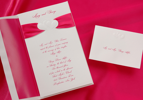 Our Hot Pink double hearts wedding invitation package is sure to please all