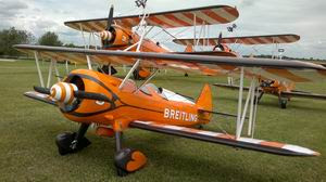 Breitling Stearman number 3 model with 2 of the full size in the background