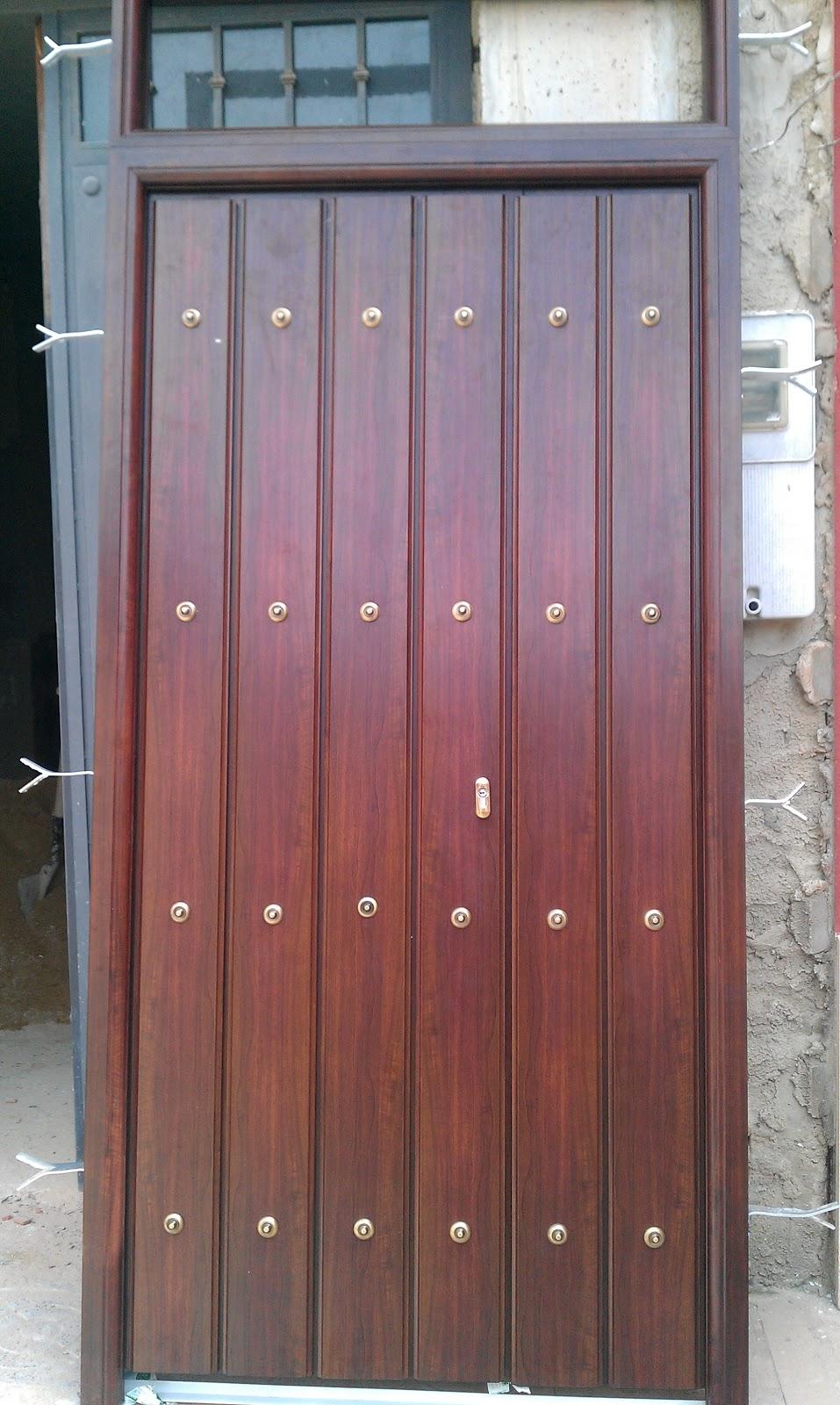 Puertas de entrada de aluminio car interior design for Puerta entrada aluminio