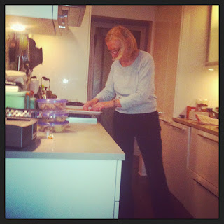 My mum. Cooking.