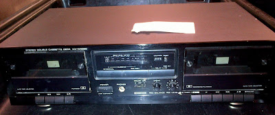 A gun and four magazines were concealed inside this tape deck.