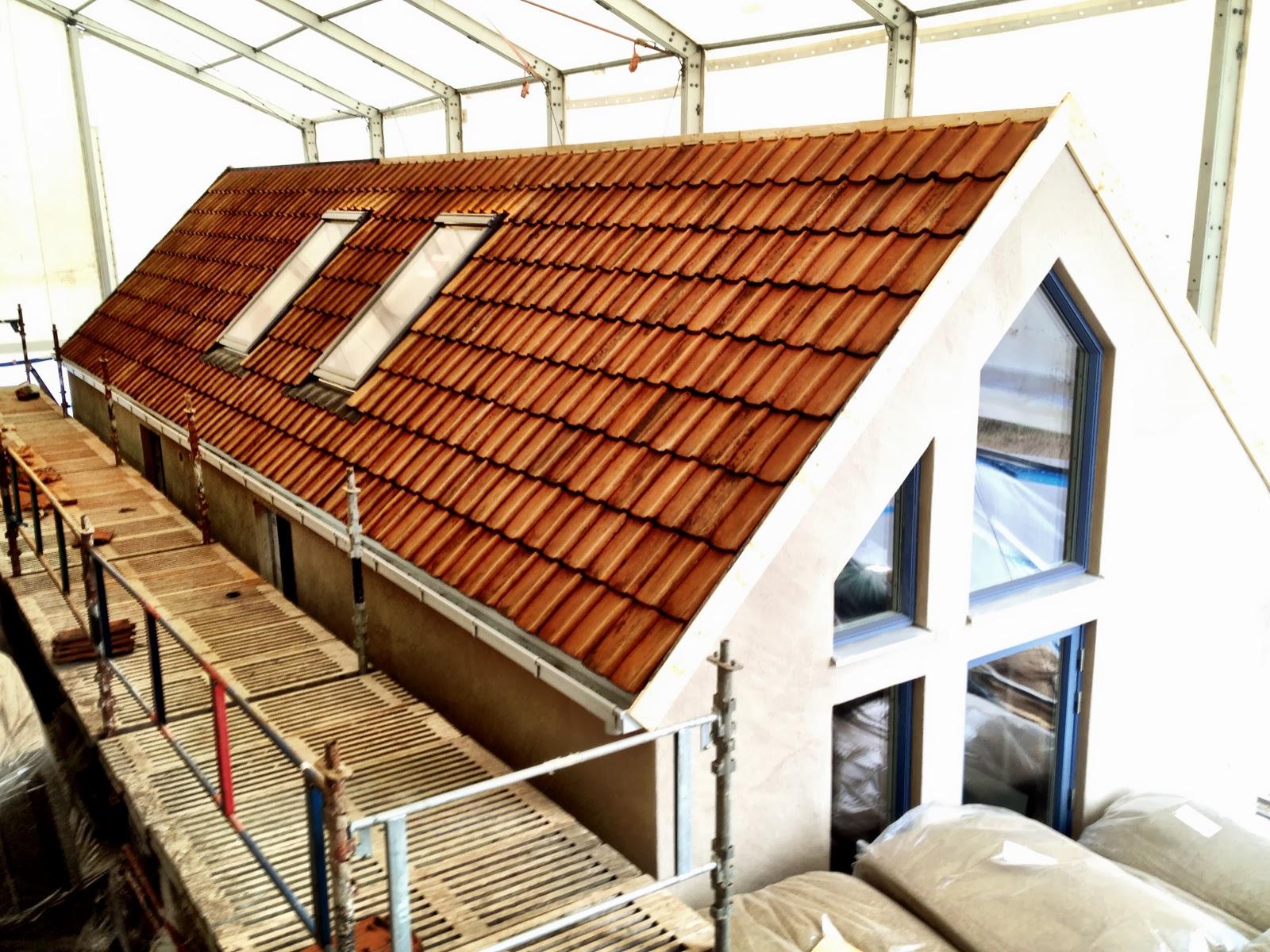 villa natura ekologiskt lågenergihus Österlen tegel tak