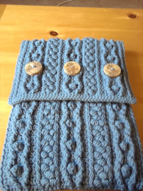 http://www.ravelry.com/patterns/library/bobble-wrap-laptop-sleeve