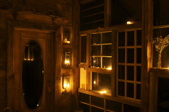 sunset house lit by candles