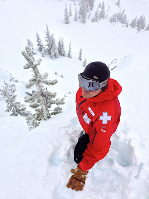 Ski Patroller C.S. Stands on top of a chute in the Mt. Hood backcountry