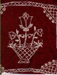 embroidery on burgundy velvet fabric