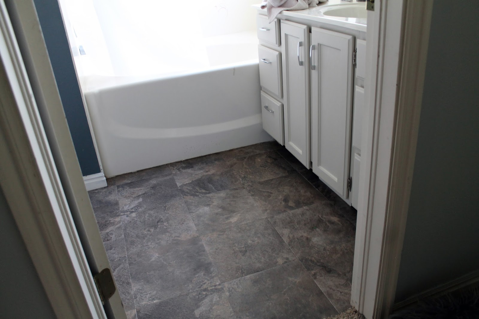 Bathroom floor vinyl tiles - You Could Grout The Tiles To Make Them Look Even More Real But We Were Happy Just Laying Them On The Existing Floor Right Next To Each Other