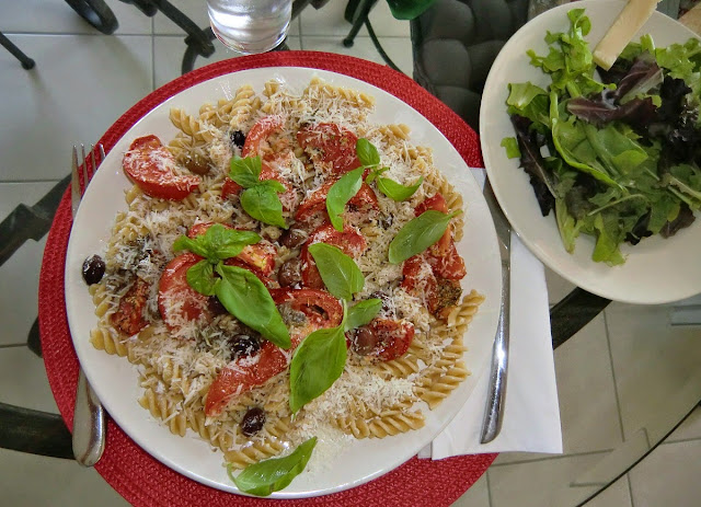 Pasta with roasted tomatoes anchovies and basil