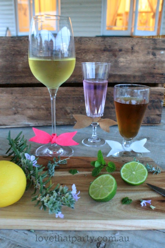 Pretty ideas for your next gathering, wine glass bow ties. Helps guests find their glass and look cute too! via Love That Party