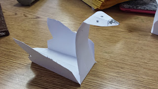 http://www.artistshelpingchildren.org/kidscraftsactivitiesblog/2010/03/how-to-fold-a-standing-paper-goose-and-duck-with-paper-arts-instructions/