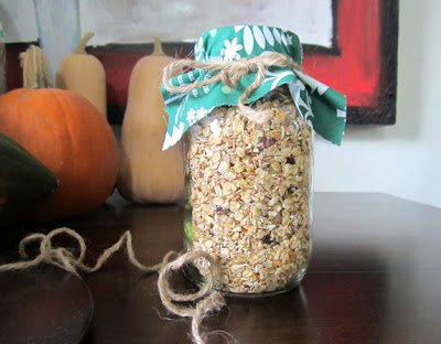 Jar of homemade granola with holiday fabric decoration