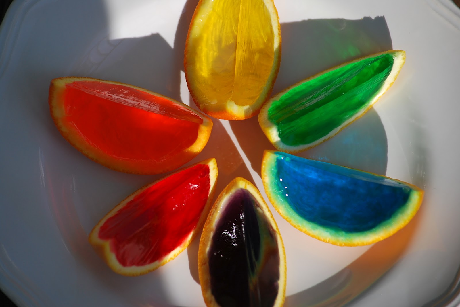 saw this idea for rainbow gelatin orange wedges on pinterest and I ...