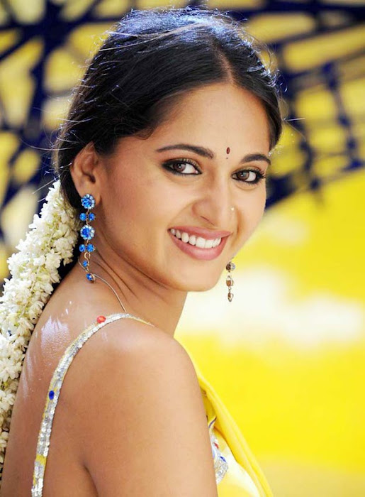 anushka in yellow saree photo gallery