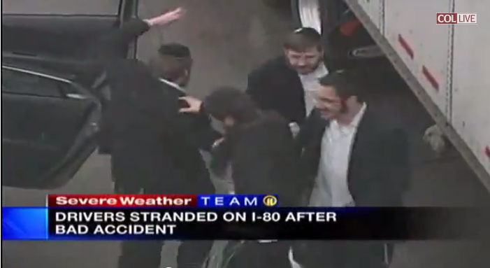 Hasidic Jewish dancing during traffic jam on interstate I-80
