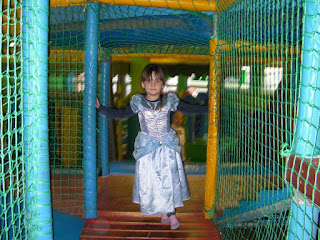 girl dressed as a princess in a cage