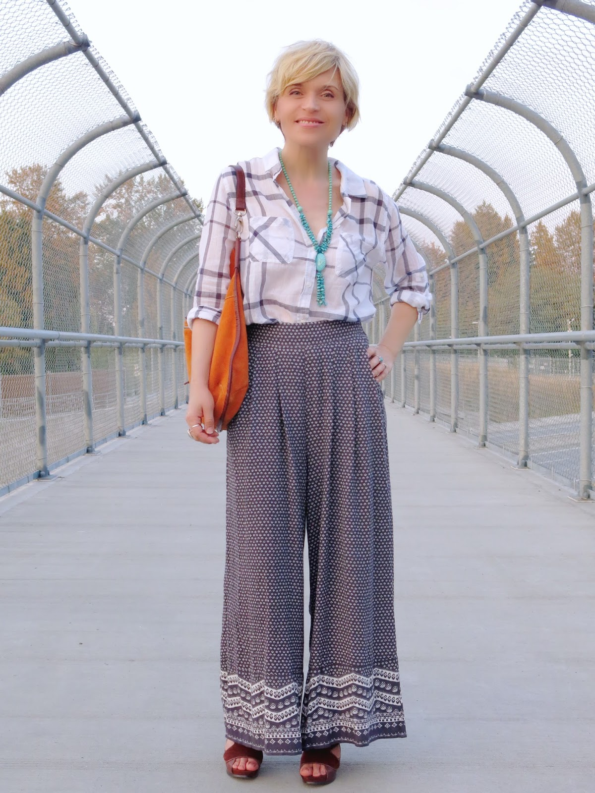 styling palazzo pants with a plaid boyfriend shirt and colourful accessories