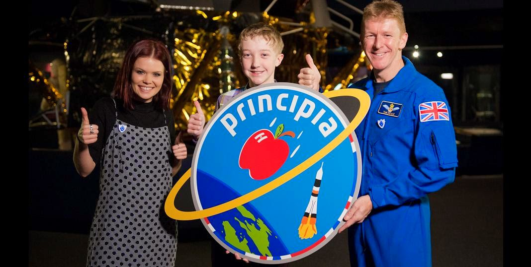 BBC presenter Lindsay Russel, logo designer Troy and ESA astronaut Tim Peake with the Principia mission logo. Credit: ESA-M. Alexander