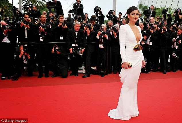 Starlet: Cheryl's arrival sent the photographers into a mad panic, with them all attempting to get the best shot