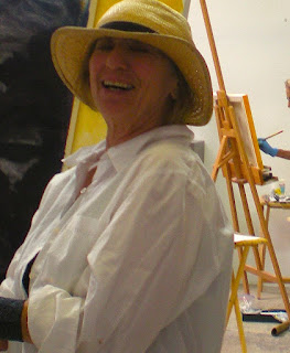Sefla Joseph teaching art class, big grin on her face