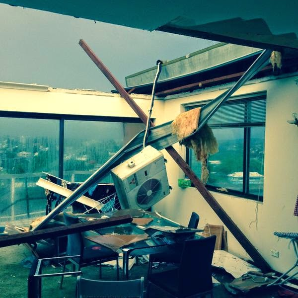 Photo of apartment with its roof ripped off by the storm