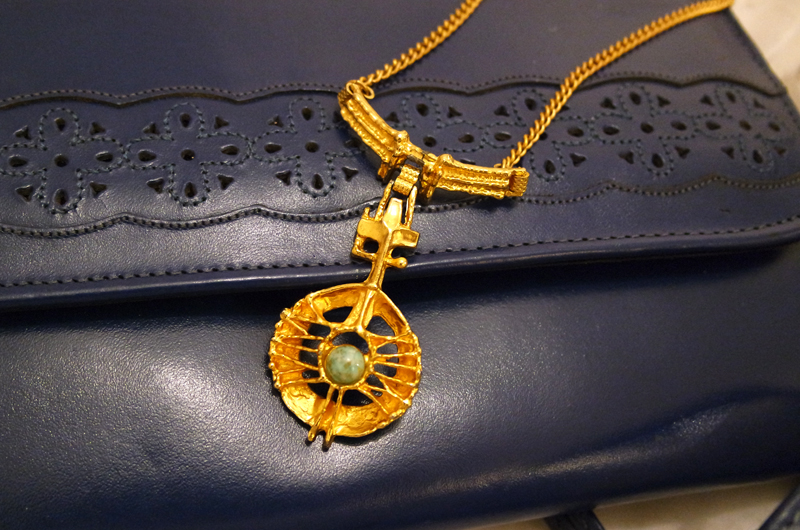 vintage gold necklace with stone