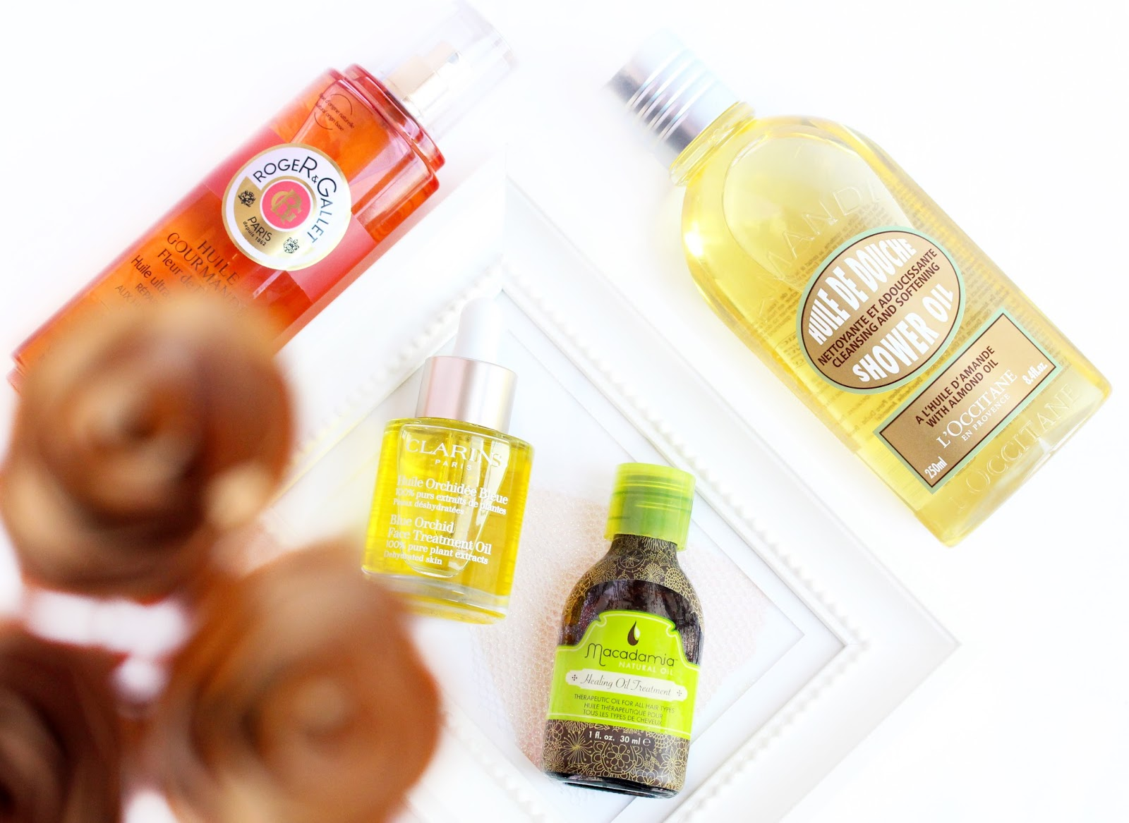 Beauty Oils: Macadamia Healing Treatment Oil, Roger&Gallet Body and Hair Oil, Clarins Blue Orchid Treatment Oil, L'Occitan Almond Shower Oil