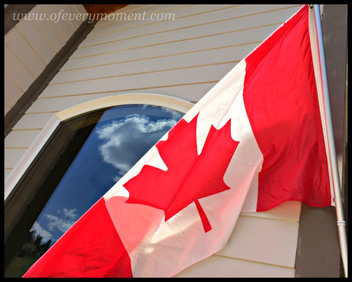 Canadian Flag, Big sky, window reflection, clouds