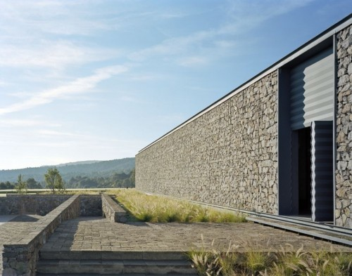 The painted blackbird stone house love for Modern stone houses architecture