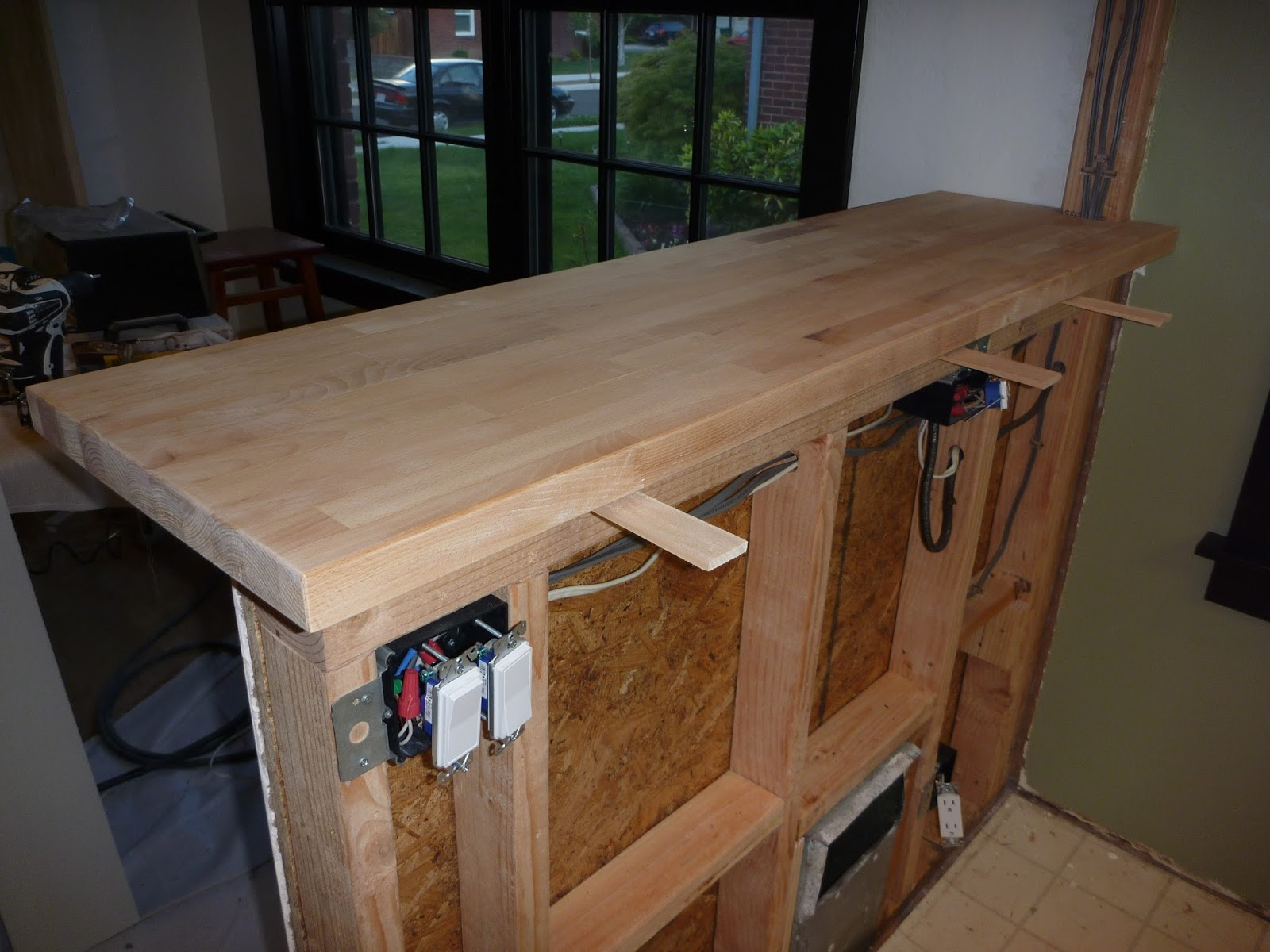 My stupid house building a sturdy half wall bar top for How to build a wall bar