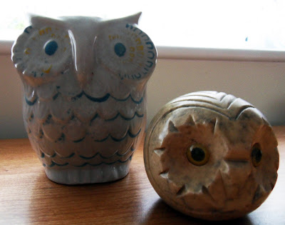 Owl ornaments, a paper weight and a vase