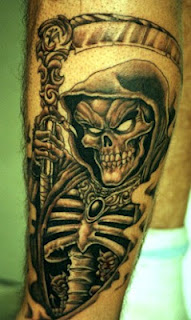 grim reaper / skeleton tattoo on the arm