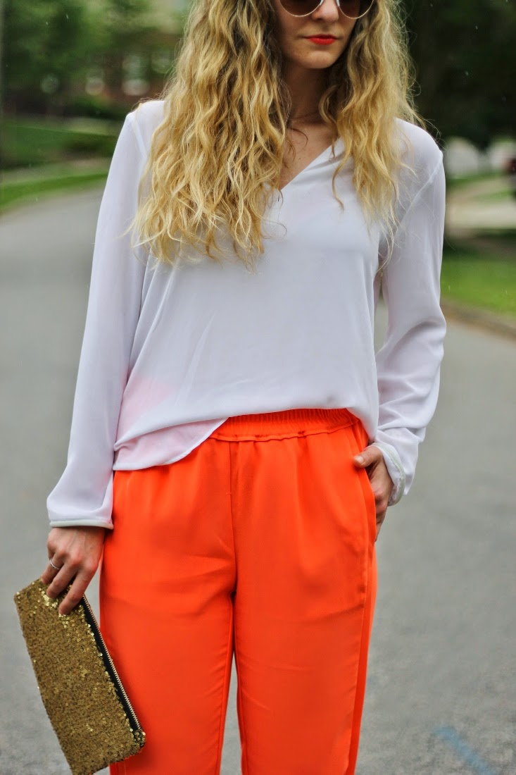 Neon orange pant and white blouse