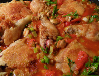 Chicken and Sauce in Pan Simmering