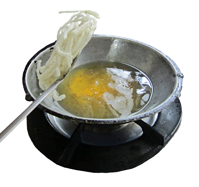 food being fried in hot oil