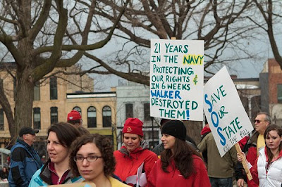 Protest with sign that says, 21 years in the Navy protecting our rights, and in 6 weeks Walker destroyed them.