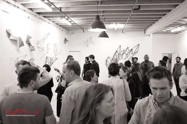 Opening night art crowd at Heavy Weather at China Heights Gallery, Dion Horstmans work on two walls.  Photographed by Kent Johnson for Street Fashion Sydney.