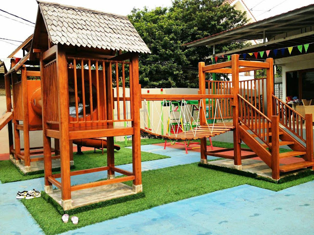 adorable backyard for kids chic wooden playhouse and bridge small concrete path decor
