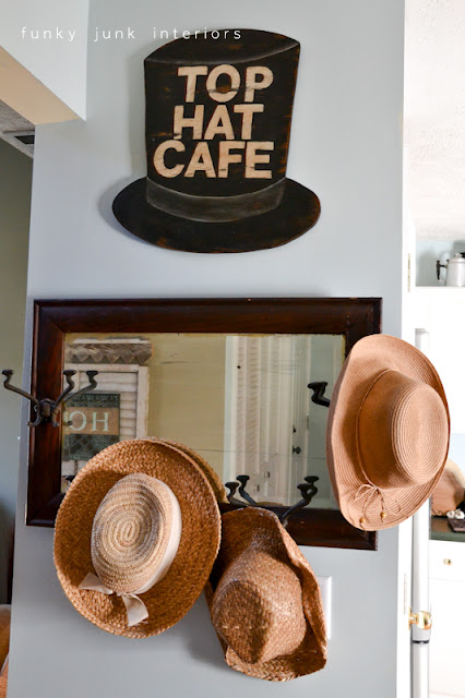 A junk tour of Bella Rustica Linda's house via Funky Junk Interiors - hat wall