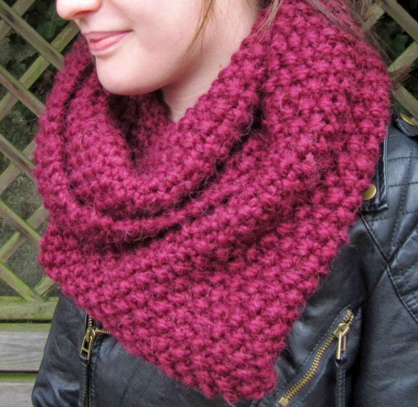 Photo of model wearing knitted cowl