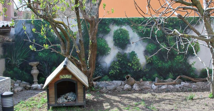Trompe l 39 oeil pour un jardin avec fausse plante sur un mur - Trompe l oeil exterieur jardin ...