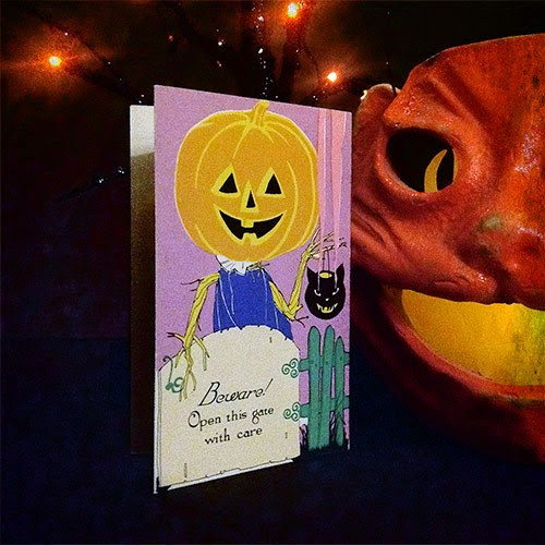 Vintage Halloween collectible card by Hallmark 1920s features Jack O'Lantern trick or treater with smoking cat lantern