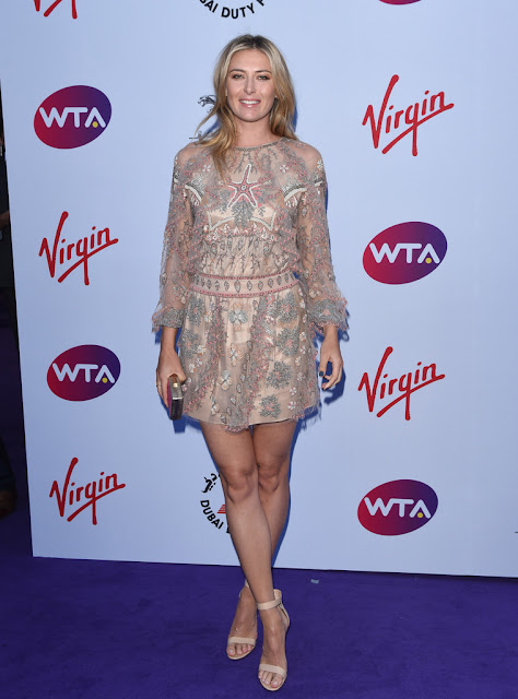 Maria Sharapova stunning leggy poses at WTA party carpet photo 5