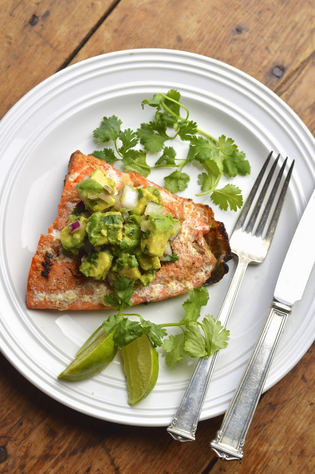 Grilled salmon with a fresh avocado salsa with lime and fresh cilantro