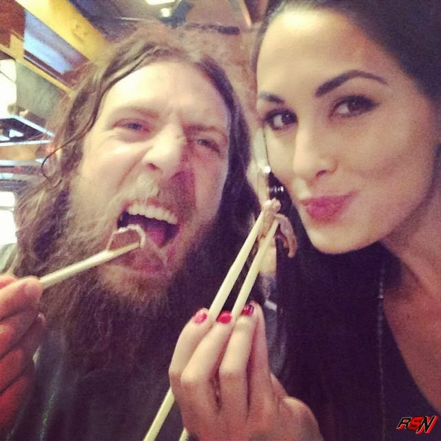 Bryan and Brie Enjoying Some Food.