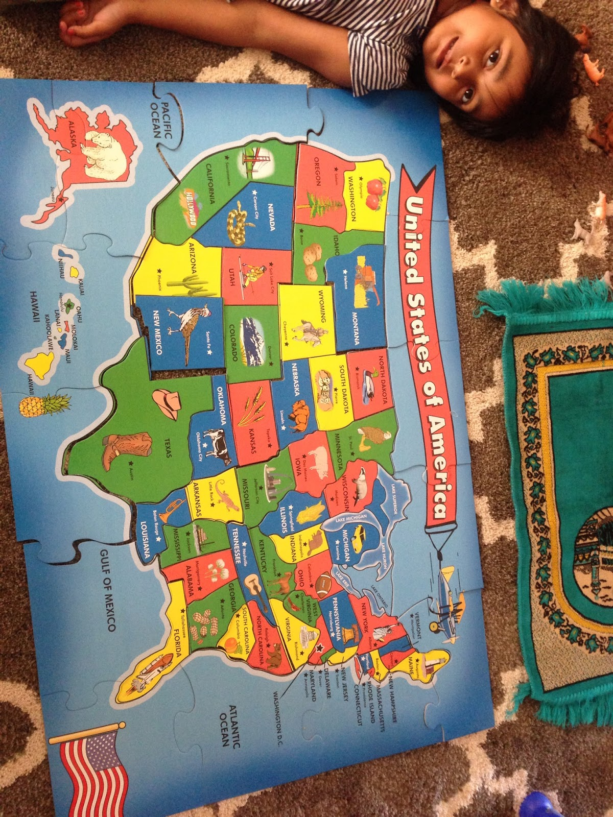 suhaila with her recently solved puzzle of united states map