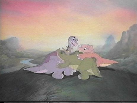 dinosaurs group hug in The Land Before Time 1988 animatedfilmreviews.filminspector.com