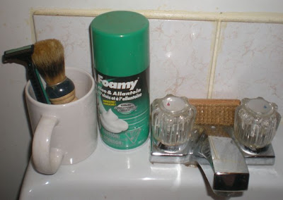 disposable razor, shaving brush, white mug, shaving cream, shaving kit, bathroom sink