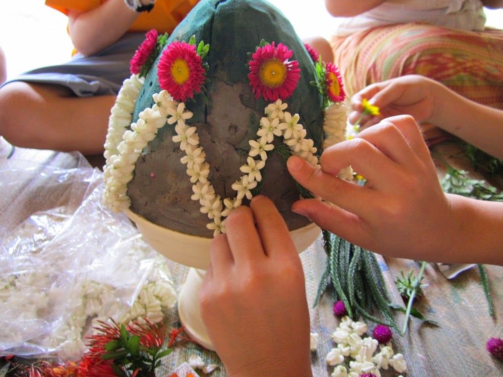Creating traditional Thai poom flower arrangement