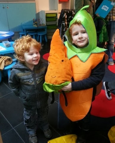 Boy dressed as a carrot