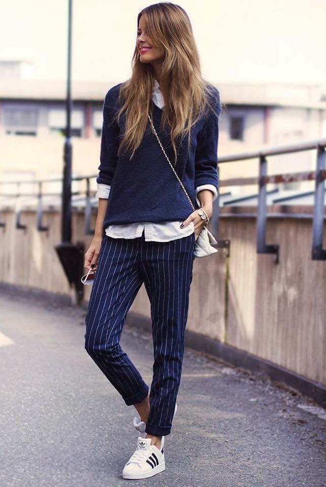 Annette Haga on Just the Design. Blue pinstripe pants, white shirt, blue sweater and sneakers. I'd wear this in Paris.